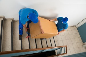 12680885-two-movers-with-box-on-staircase